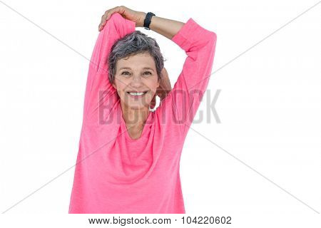 Portrait of happy woman exercising against white background