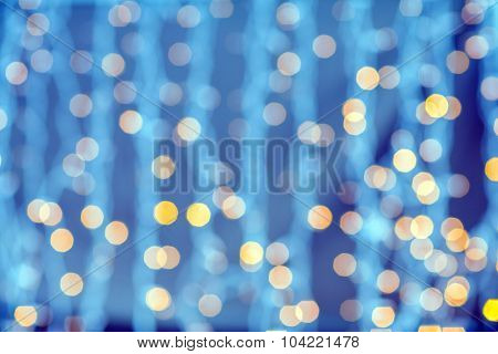 holidays, party and celebration concept - blurred golden lights background