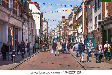 ROCHESTER, UK - MAY 16, 2015: Rochester high street at weekend. People walking through the street, p