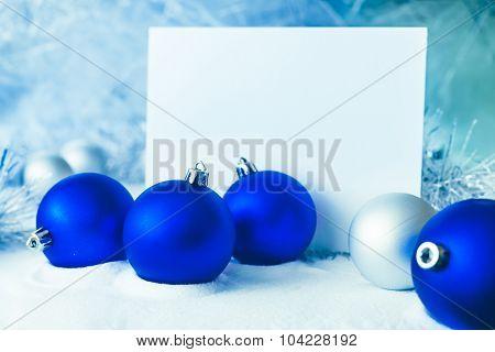 Blue Christmas balls on the white snow