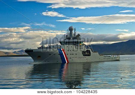 Coast guard ship entering Reykjavik harbor after early morning patrol