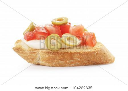 crostini with tomato, mozzarell and olives isolated