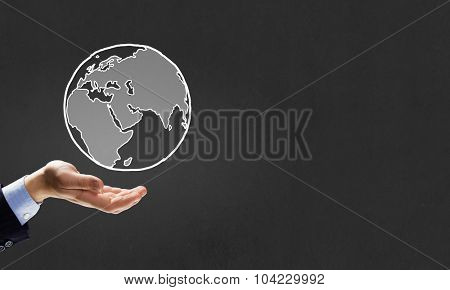 Human hand presenting on palm planet Earth