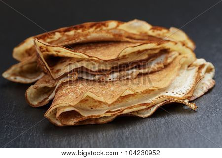 thin crepes or blinis folded in triangles