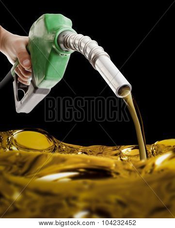 Male hand pumping fuel on black
