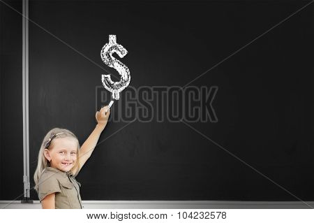 Cute school girl drawing dollar sign on blackboard
