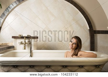 Smiling Girl In A Bathtub