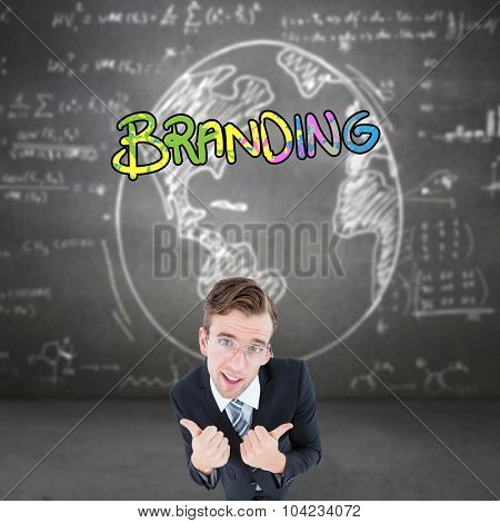 Geeky businessman with thumbs up against white graphics on black wall