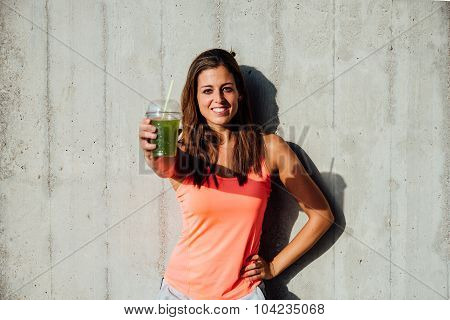 Healthy Fitness Woman Holding Detox Smoothie