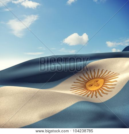 Argentina flag waving in wind against blue sky with clouds