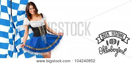 Pretty oktoberfest girl spreading skirt against oktoberfest graphics