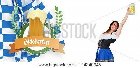 Pretty oktoberfest girl raising beer tankard against oktoberfest graphics