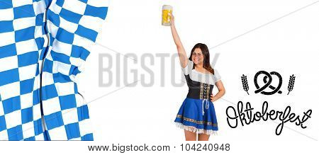 Pretty oktoberfest girl raising beer tankard against oktoberfest graphics