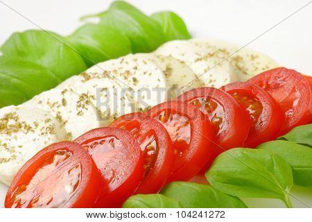 detail of mozzarella, tomatoes and fresh basil