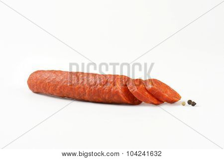 sliced pepperoni sausage on white background