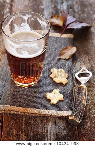 Glasse Of Light Beer, Crackers And Beer Bottle Opener