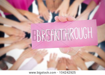 The word breakthrough and young woman holding blank card against oktoberfest graphics