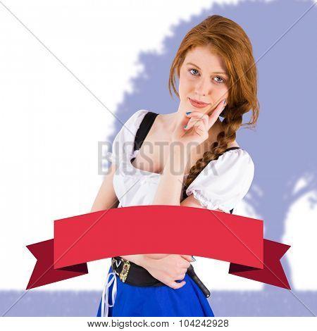 Oktoberfest girl smiling at camera against red banner