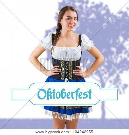 Pretty oktoberfest girl with hands on hips against oktoberfest banner