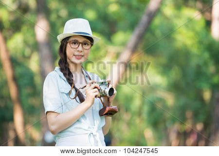Beautiful Asian Girl Smiling With Retro Camera Photographing, Outdoor