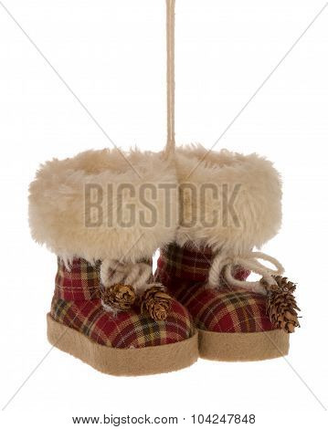 Christmas decorative little boots on the white background.
