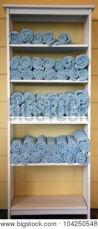 Blue Terry Cloth Beach or Pool Towels fresh from the wash ready to be used. Terry cloth towels are used because they are so absorbent and easily dry off wet people, pets, children and spills.