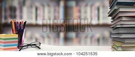Students desk against library shelf