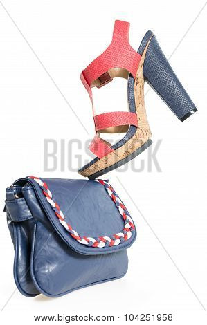 Pare Of Trendy Navy Blue And Red Shoes, With Matching Bag,  Isolated On White Background