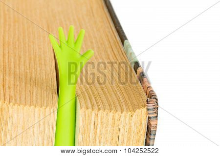 Book With Plastic Hand Bookmark Isolated On White