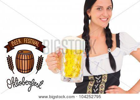 Pretty oktoberfest girl holding beer tankard against oktoberfest graphics