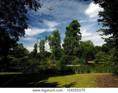 Lake at Kew Gardens London UK with Airplane overhead