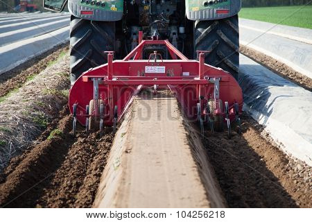 DUSSELDORF, GERMANY - APRIL 2015: Modern agriculture machines on asparagus field