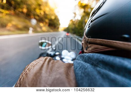 Man seat on the motorcycle on the forest road.
