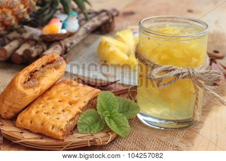 Pineapple Juice And Fresh Pineapple With Bread Baked With Pineapple.