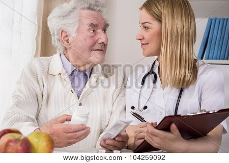 Doctor Examining Male Patient