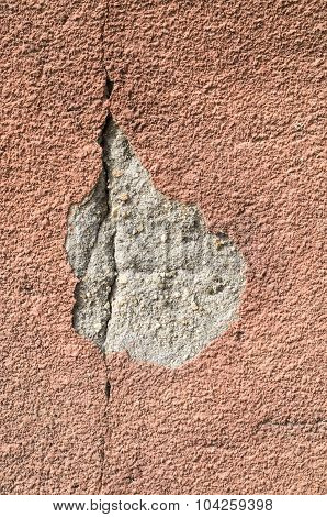 Brown Crack And  Fallen Off Plaster On Wall