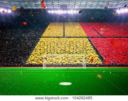 Flag Belgium of fans. Evening stadium arena Blue
