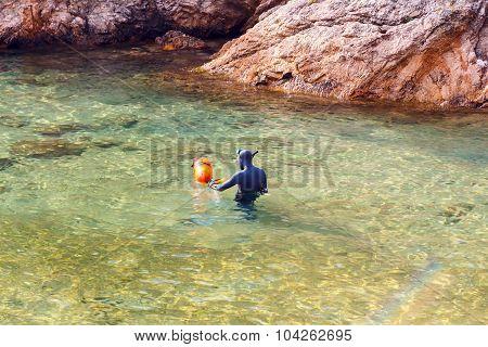 Diver in the bay of Cala Bona. Tossa de Mar.