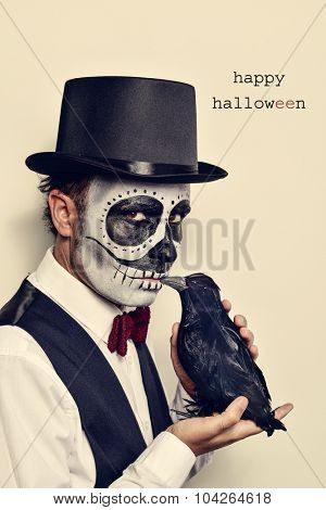 a man with calaveras makeup, wearing bow tie and top hat, with a black crow in his hand, and the text happy halloween