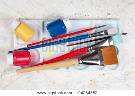 Various brushes and paint