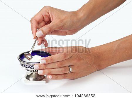 Woman hands serving salt