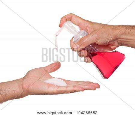 Man dispensing hand soap
