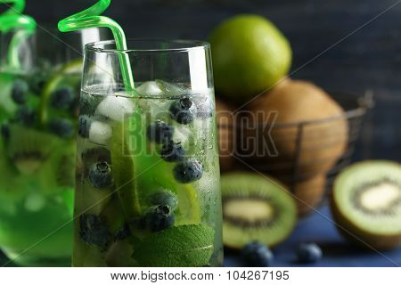 Kiwi and Blueberry cocktails on color wooden background