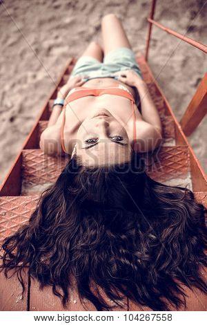 Long Hair Girl Relaxing On The Beach