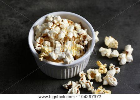 Popcorn in bowl on dark background