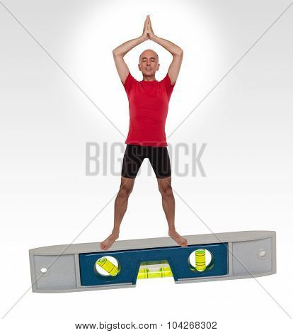 Man doing yoga standing no a level