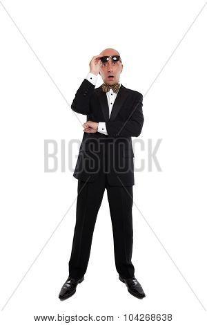 Shocked looking man wearing a tuxedo