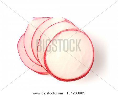 Slices of fresh red radish isolated on white