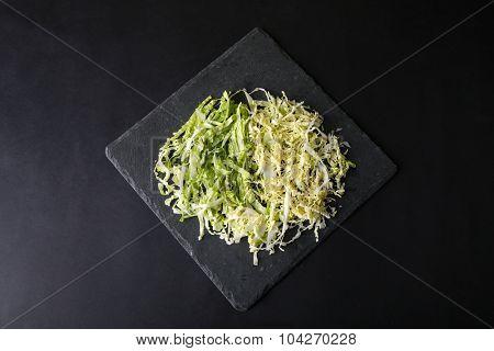 Cut savoy cabbage on dark grey background
