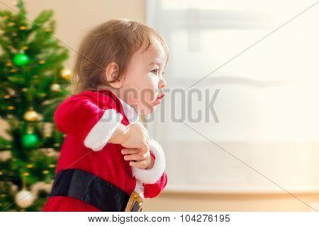 Little Toddler Girl Running To Open Christmas Presents